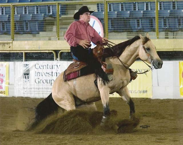 Dexter on Wisper at the '08 International Reining Festival in Denver.